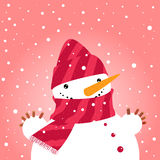 Snowman in hat. Snowman in red hat and scarf Stock Photo