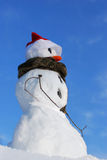 Snowman with hat, carrot nose Stock Image