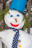 The snowman. Snowman hat made of blue plastic buckets, standing at the wooden fence stock images