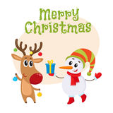 Snowman in hat and mittens with Christmas reindeer in scarf Stock Images