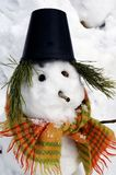 Snowman in a hat and a scarf Stock Photo