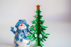 Christmas decoration: snowman and christmas tree royalty free stock photo