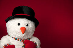 Snowman with hat and scarf on red background Stock Image