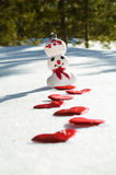 Snowman with heart footpath Stock Photo