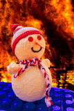 Snowman in hell. Snowman with fire and flames in the background Royalty Free Stock Photography