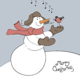 Snowman and his friend - bullfinch. Stock Photos