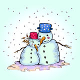 Snowman and his girlfriend in love. Snowman hugging his snow girlfriend Stock Photo
