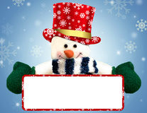 Snowman holding blank banner Royalty Free Stock Image