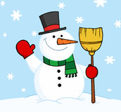 Snowman holding a broom and waving Royalty Free Stock Photography