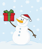 Snowman holding a christmas present Stock Image