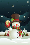 Snowman holding Christmas present Royalty Free Stock Photo