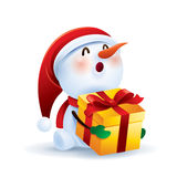 Snowman holding gift box Royalty Free Stock Photos