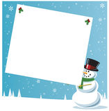 Snowman holding gift tag Stock Photo