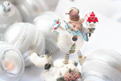 Snowman holding gifts Stock Image