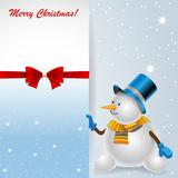 Snowman holding a Greeting Card with the Christmas. Royalty Free Stock Photo