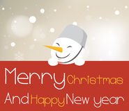 Snowman holding red christmas board. Royalty Free Stock Image