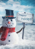 Snowman holding wooden sign Royalty Free Stock Photo