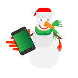 Snowman holds a mobile phone Stock Photos