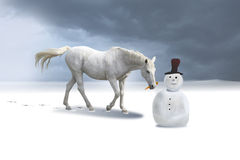 The snowman and the horse in a winter landscape.