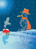 Snowman with house. In snowfall Royalty Free Stock Images