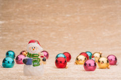 Snowman with Сhristmas balls. On illuminated background Royalty Free Stock Photography