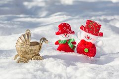 Snowman husband and wife are beautifully dressed smiling. My first Christmas. To give birth to a child for Christmas and New Year. A happy family of snowmen Royalty Free Stock Image