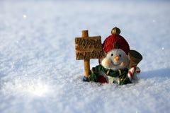 Snowman i snowen Royaltyfri Bild