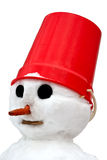 A snowman isolated . A snowman with a red pail on his head isolated on white background Royalty Free Stock Image