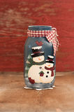 Snowman jar. With aged wood in background creating an antique feel Stock Photography