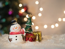 Snowman jolly to smile celebrate and box bokeh background Stock Photography