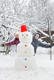 Snowman and kids Stock Photography