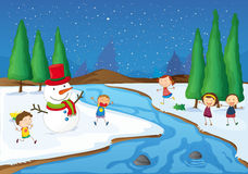 A snowman, kids near river Royalty Free Stock Images