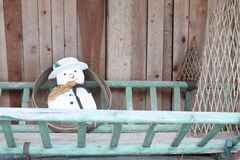 Snowman on a ladder Stock Photography