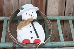 Snowman on a ladder Stock Images