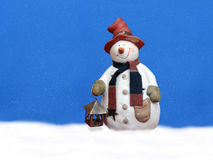 Snowman with lantern Stock Image