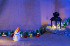 Snowman and lantern stock images