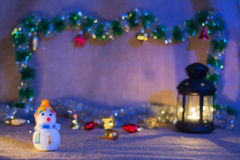 Snowman and lantern royalty free stock photos