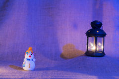 Snowman and lantern stock photos