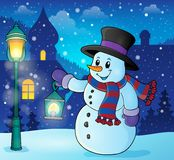Snowman with lantern theme image 2 Royalty Free Stock Photography