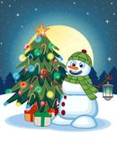 Snowman With A Lantern And Wearing A Head Cover And A Green Scarf With Christmas Tree And Full Moon At Night Background For Your D Stock Photos