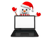 Snowman with laptop Stock Images