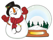 Snowman and large snow ball Royalty Free Stock Photos