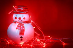Snowman with light bulb Stock Photography
