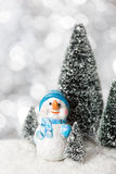 Snowman with lights in the background. Royalty Free Stock Photos