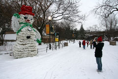 Snowman in Lincoln Park at winter. CHICAGO, IL, US - FEBRUARY 01, 2007: Unidentified visitors visit big snowman in Lincoln Park with snow at winter in Chicago Royalty Free Stock Photos