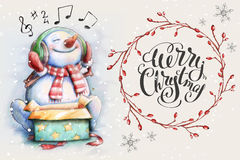 Snowman listening Christmas song Stock Image