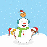 Snowman with little cute kids and love bird. Royalty Free Stock Photo