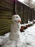 Snowman. Little snowman on the garden Stock Photography