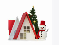 Snowman, little houses and christmas tree Stock Photos