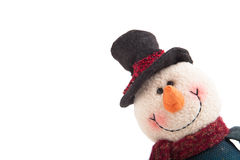 Snowman looking out of the corner isolated on a white background Stock Photo